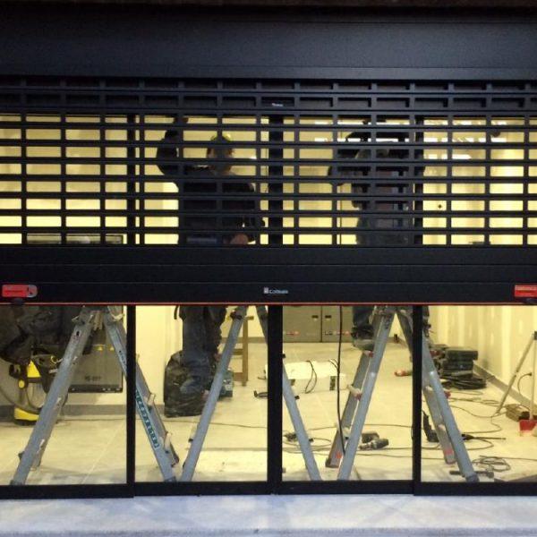 Puerta DUET (Persiana con puerta de cristal integrada)