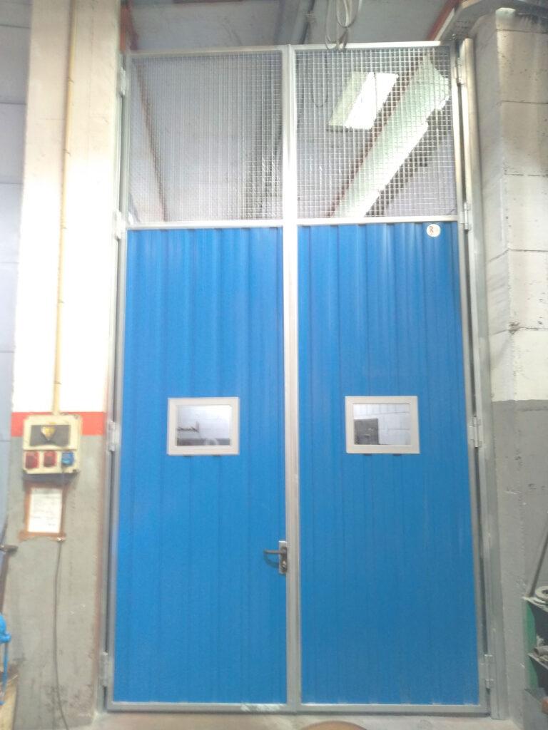 Portal contrapesado vertical y batiente industrial instalados en Vigo 8